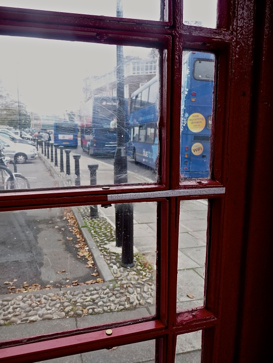 From inside to outside a red telephone box